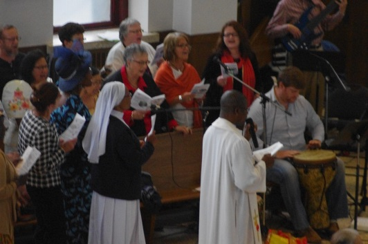 Fr Odumuko singing